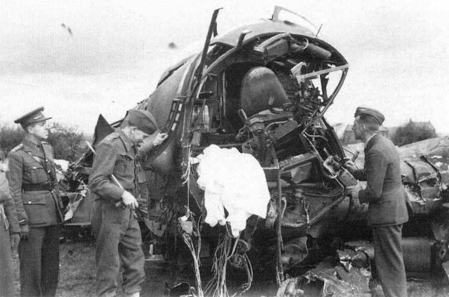 Heinkel He111H-5 3520: A close view of the damaged cockpit with parachute.