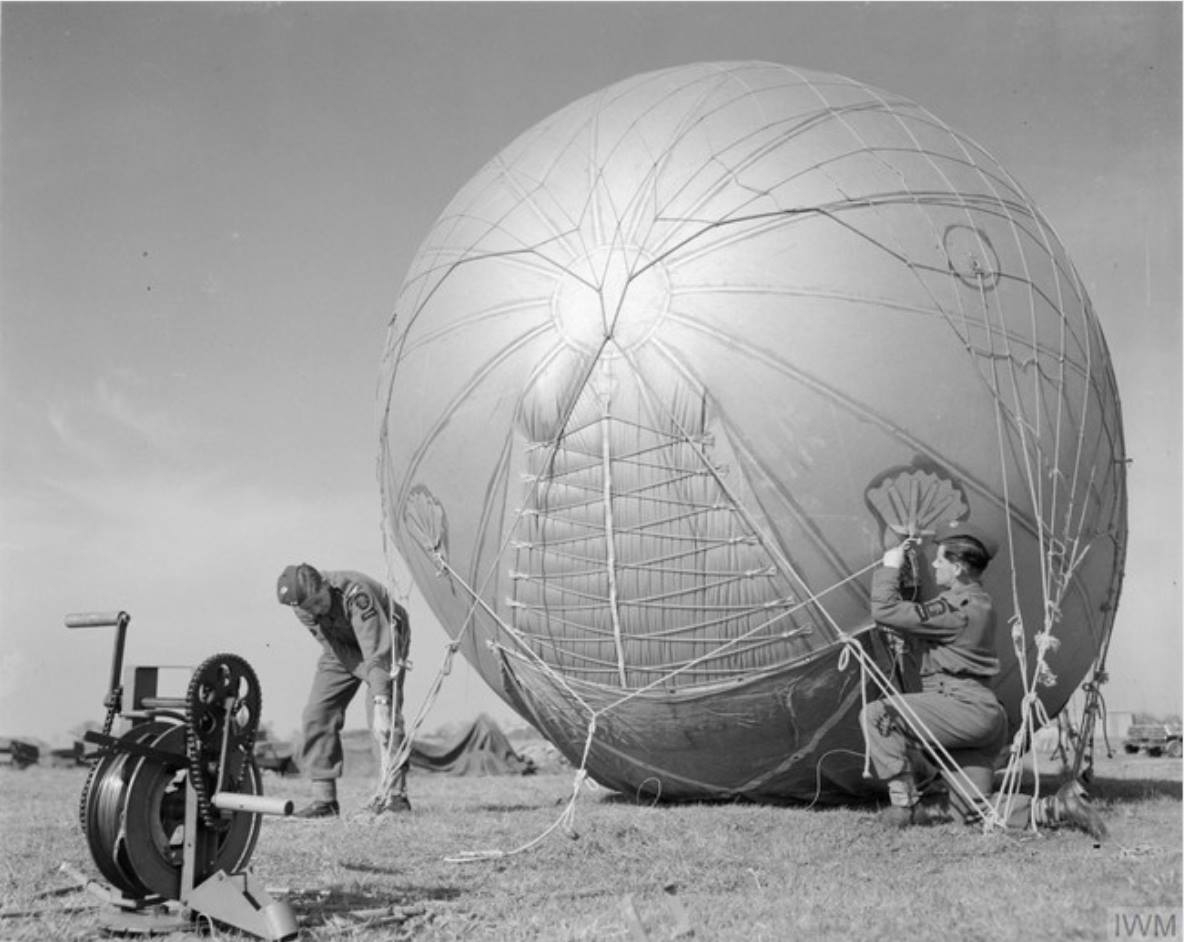 A team preparing to launch a barrage balloon. Notice the winch in the foreground.  (C) IWM (CH 13212)